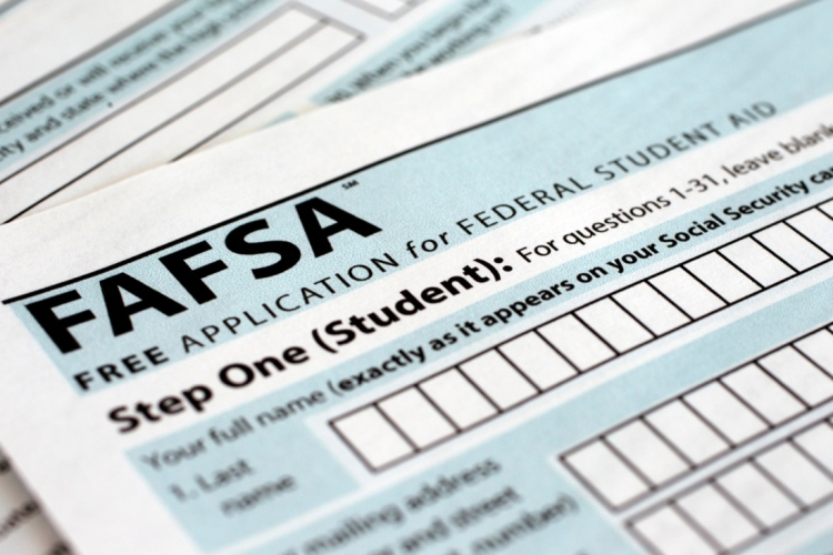 The Free Application for Federal Student Aid (FAFSA) form is photographed in Frederick, Md., Sunday, Jan. 26, 2014.  (AP Photo/Jon Elswick)